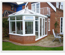 Example of victorian style conservatory with ornate detailing and wall